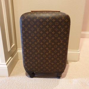57c837c0c7ff Louis Vuitton. Louis Vuitton Monogram Zephyr 55 Rolling Suitcase